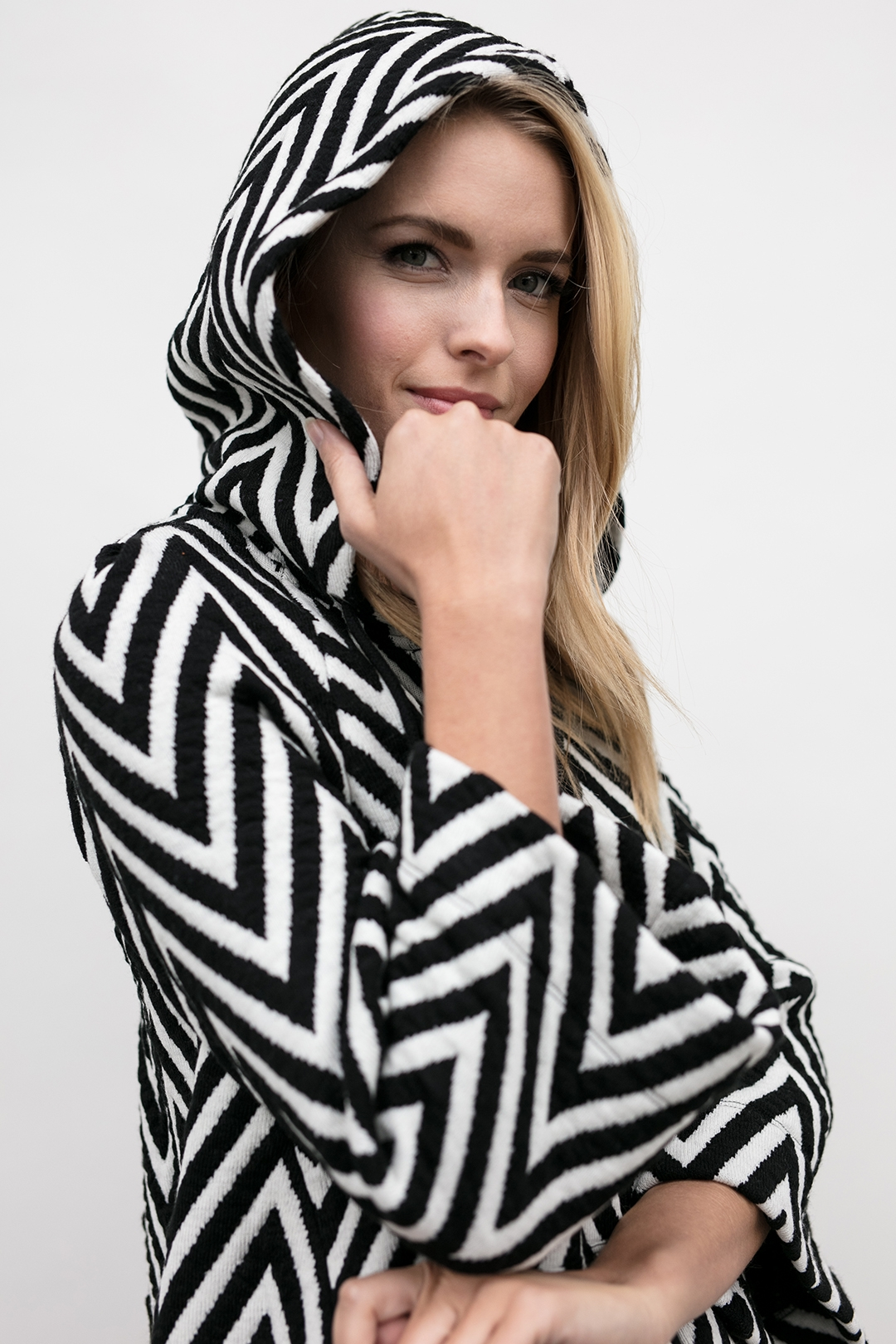 up close shot of hood on the chevron knit hoodie, the Lucy